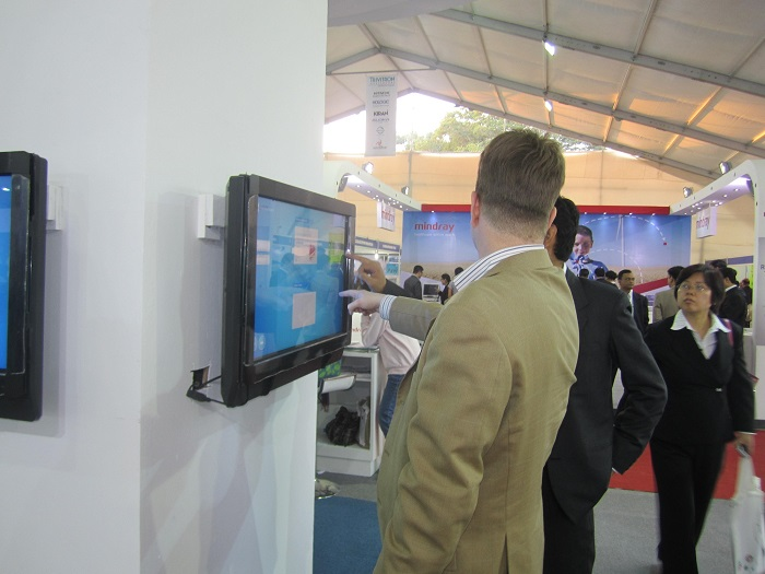 Visitors engaged with TouchMagix MagixKiosk